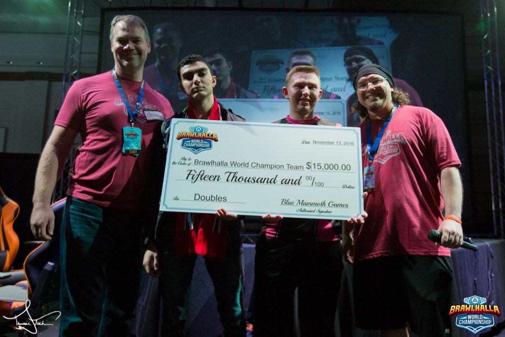 (From Left) Matt Woomer, Co-Founder of Blue Mammoth Games award $15,000 to Eanix | Diakou and 3sUP | Twilight alongside eSports Director David Kisich at the end of the 2v2 tournament of the Brawlhalla World Championship.