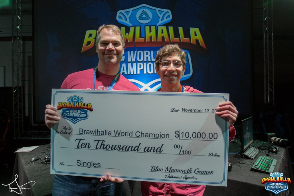 Brawlhalla Co-Founder Matt Woomer presents world champion LDZ with a check for $10,000 after winning the 1v1 Brawlhalla World Championship tournament.